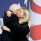 ** FILE ** Former Vice President Dick Cheney hugs his daughter Liz Cheney after she surprised the Conservative Political Action Conference (CPAC) by bringing him as her guest, on Thursday, Feb. 18, 2010, in Washington. (AP Photo/Cliff Owen)