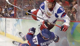 Russia's Alexander Ovechkin (8) collides with Slovakia's Lubos Bartecko (23) in the first period of a preliminary round men's ice hockey game at the Vancouver 2010 Olympics in Vancouver, British Columbia, Thursday, Feb. 18, 2010. (AP Photo/Julie Jacobson)