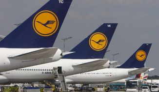 **FILE** Aircraft of the German airline Lufthansa are parked at Frankfurt Airport, the carrier's principal hub, in this 2008 photo. (Associated Press)