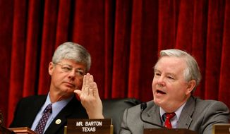 Rep. Joe Barton, R-Texas, right, speaks as House Oversight and Investigations subcommittee Chairman Rep. Bart Stupak, D-Mich., listens, during the subcommittee's Toyota hearing on Capitol Hill in Washington, Tuesday, Feb. 23, 2010. (AP Photo/Gerald Herbert)