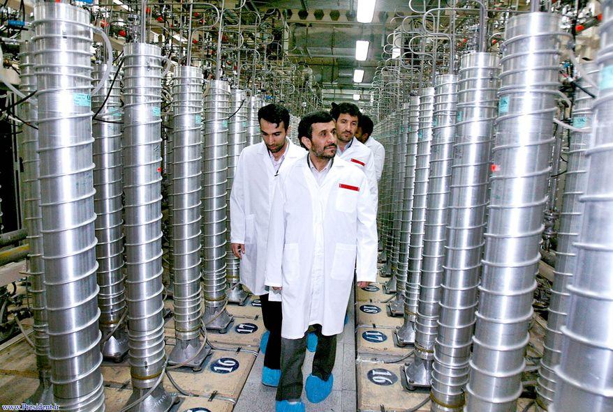 Iranian President Mahmoud Ahmadinejad visits a uranium-enrichment facility about 200 miles south of Iran's capital, Tehran, in April 2008. (Associated Press)