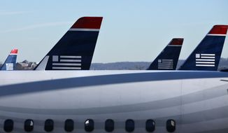US Airways planes are seen at Reagan National Airport near Washington in December 2009. (AP Photo) ** FILE **