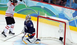 Canada's Sidney Crosby celebrates as he score on USA's Ryan Miller to win in overtime of the gold medal men's ice hockey game at Canada Hockey Place in Vancouver, Canada, during the 2010 Winter Olympics on February 28, 2010.   UPI/Roger L. Wollenberg