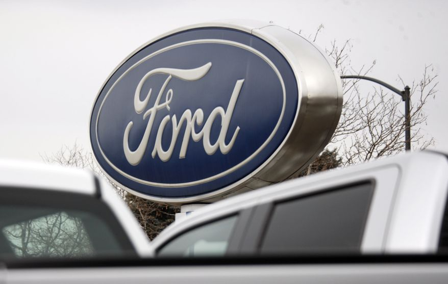 Ford Motor Co.'s sign hangs over the lot at a Ford dealership in Littleton, Colo., on Sunday, Feb. 28, 2010. (AP Photo/David Zalubowski)
