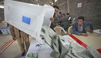 Election workers start the initial counting of votes cast by those entitled to vote early, at a counting center in Najaf, Iraq, Friday, March 5, 2010.  Early voting for detainees, hospital patients and military and security personnel took place Thursday, with Iraq's parliamentary elections due on Sunday, March 7, 2010. (AP Photo/Alaa al-Marjani)