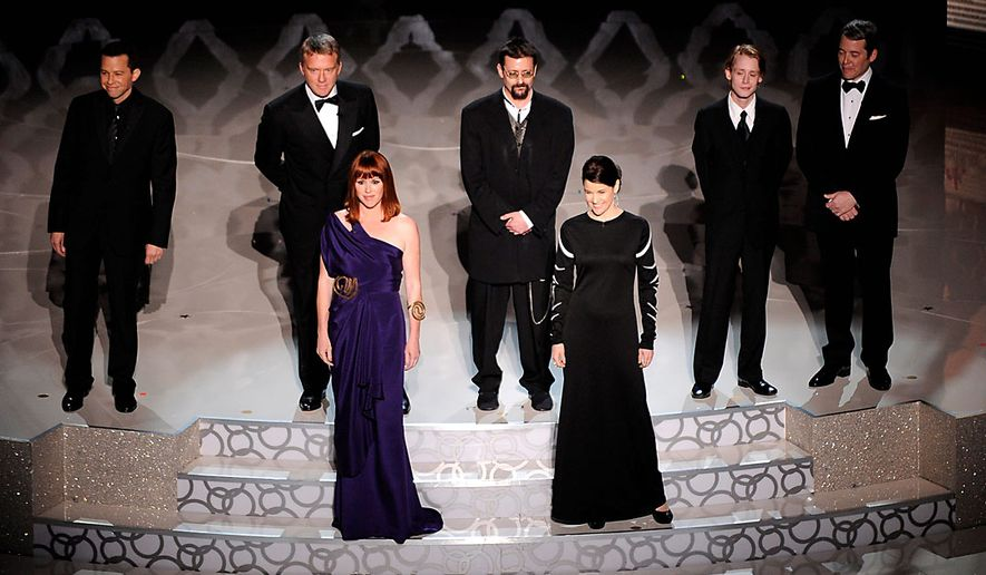 From left, Jon Cryer, Anthony Michael Hall, Molly Ringwald, Judd Nelson, Ally Sheedy, Macaulay Culkin, and Matthew Broderick seen during a tribute to the late director John Hughes at the 82nd Academy Awards Sunday, March 7, 2010, in the Hollywood section of Los Angeles. (AP Photo/Mark J. Terrill)