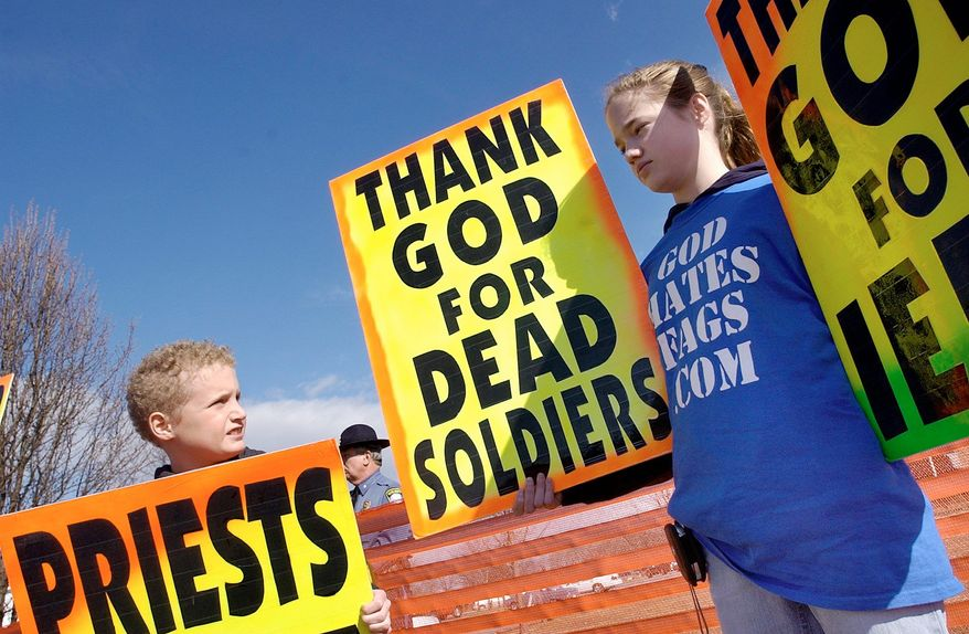 Westboro Baptist Church member Gabriel Phelps-Roper, 10, and sister Grace Phelps-Roper, 13, protest at the funeral of Marine Lance Cpl. Matthew A. Snyder in 2006. (Associated Press)