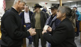 Rep. Bart Stupak (left), Michigan Democrat, speaks with Elin Richardson of Rapids City, Mich., after a town-hall meeting in Tawas City, Mich., on Monday, March 8, 2010. (AP Photo/Carlos Osorio)
