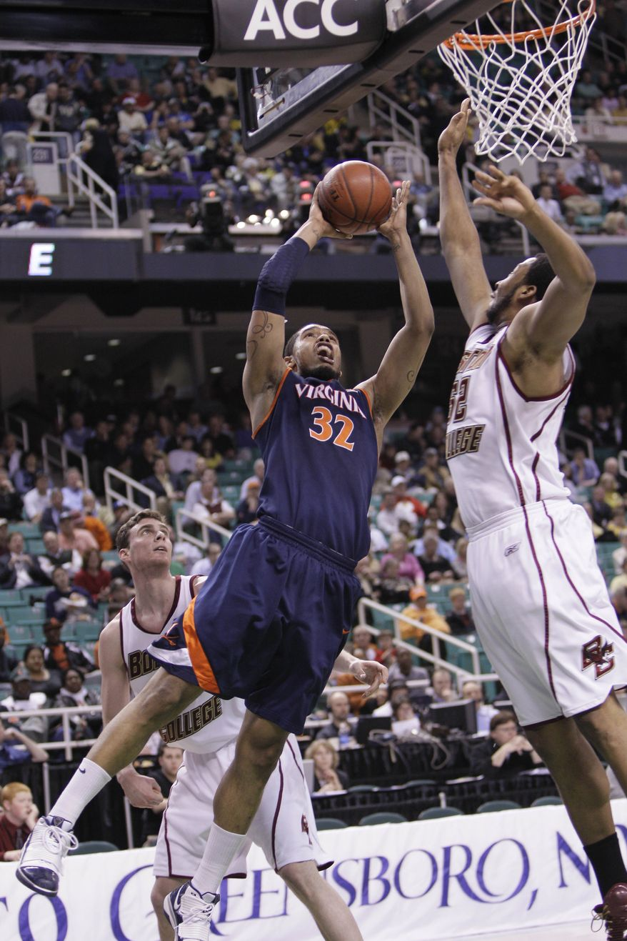 ASSOCIATED PRESS FILE Virginia's Mike Scott (32) goes to the hoop as Boston College's Josh Southern (52) defends in the second half of an NCAA college basketball game in the Atlantic Coast Conference tournament in Greensboro, N.C., Thursday, March 11, 2010.