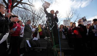Rep. Louie Gohmert, Texas Republican, holds up a copy of the proposed Senate health care reform bill as he speaks at a rally sponsored by the American Grassroots Coalition and the Tea Party Express on Capitol Hill Tuesday. Congressional Republicans are united in opposition to the measure. (Associated Press)