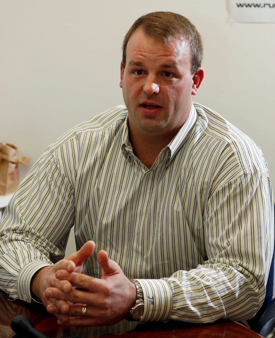 ** FILE ** In this March 17, 2010, file photo, Jon Runyan, then a Republican congressional candidate in New Jersey, answers questions a day before the formal launch of his campaign, in Mount Laurel, N.J. (Associated Press)