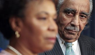 ** FILE ** Rep. Charles Rangel, D-N.Y., a founding member of the Congressional Black Caucus, listens to Caucus chair Rep. Barbara Lee, D-Calif., speak during a news conference on health care reform on Capitol Hill in Washington, Friday, March 19, 2010. (AP Photo/Haraz N. Ghanbari)