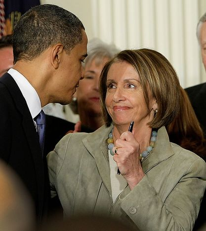 House Speaker Nancy Pelosi, California Democrat, clutches a pen used by President Obama to sign the health care bill on Tuesday, March 23, 2010, in the East Room of the White House in Washington. (AP Photo/J. Scott Applewhite)