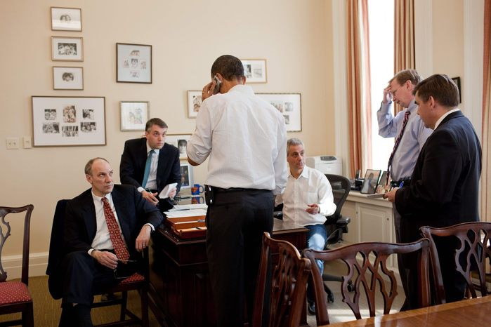 President Obama is surrounded by aides at the White House. From left, Phil Schiliro, Sean Sweeney, Rahm Emanuel, Jim Messina and Dan Turton are part of his team. More than a year into Mr. Obama's term, the people the president is most often seen huddling with in the Oval Office and the Situation Room are men, most notably press secretary Robert Gibbs and senior adviser David Axelrod, along with Mr. Emanuel, who joined the Obama team after the election. (Associated Press)