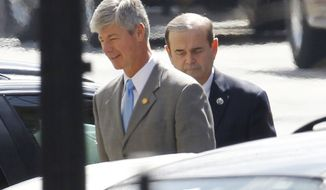 Democrat Reps. Bart Stupak of Michigan (left) and Jerry Costello of Illinois arrive Wednesday at the West Wing of the White House for President Obama's closed door signing of an executive order that reaffirms the health care reform law's restrictions on the use of federal funds for abortion. (Associated Press)