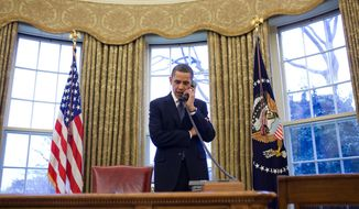 This photo provided by the White House shows President Barack Obama discussing the START treaty, during a phone call with Russian President Dmitry Medvedev, Friday, March 26, 2010, in the Oval Office of the White House in Washington. (AP Photo/Pete Souza, White House )