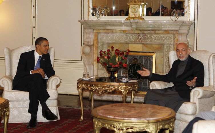 ** FILE ** President Obama meets with Afghan President Hamid Karzai at the presidential palace in Kabul, Afghanistan, on Sunday, March 28, 2010. (AP Photo/Charles Dharapak, File)