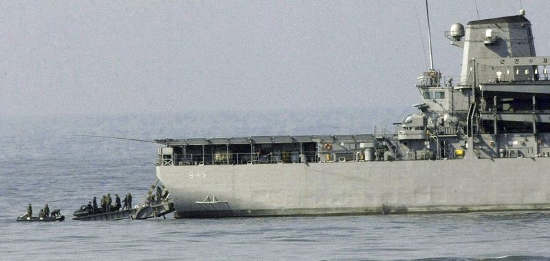 This March 29, 2010, file photo shows Ship Salvage Unit members of the South Korean Navy preparing to set out on a search mission to find missing sailors from the sunken South Korean navy ship near South Korea's Baengnyeong Island. The 1,200-ton Cheonan, on a routine patrol with other vessels, went down near the tense maritime border with North Korea following a mysterious explosion. On July 9, 2010, investigators from South Korea, the U.S., Britain, Australia, Canada and Sweden concluded that it was struck by a torpedo of North Korean origin. (AP Photo/Ahn Young-joon)