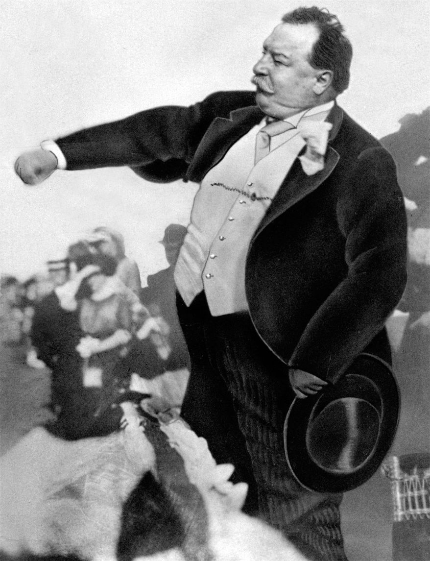 In this 1912 black-and-white file photo, President William Howard Taft is seen throwing out the first ball on opening day for baseball, to start the season for the Washington Senators in Washington. A hundred years ago, a portly right-hander, President Taft threw out the first pitch at a Washington Senators game, a weak lob from the stands to the great Walter Johnson. On Monday, the Nationals bring in the left-hander President Barack Obama. (AP Photo, File)