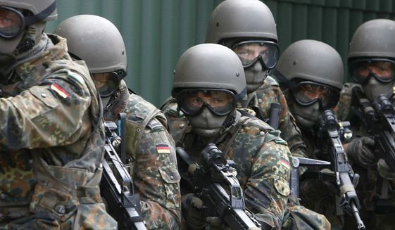 German Bundeswehr soldiers seen during a training in Seedorf, northern Germany on Aug. 25, 2008. (AP Photo/Joerg Sarbach, File) ** FILE **