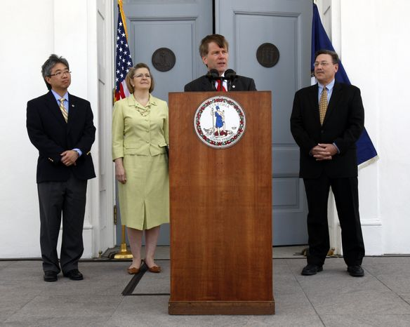 **FILE** Virginia Gov. Robert F. McDonnell (at podium) addresses President Obama's announcement of offshore oil and gas exploration as (from left) Virginia Secretary of Commerce and Trade Jim Cheng, Deputy Secretary of Natural Resources Maureen Matsen and Secretary of Natural Resources Dout Domenech look on at the Capitol in Richmond on Wednesday, March 31, 2010. (AP Photo/Richmond Times-Dispatch, Bob Brown)