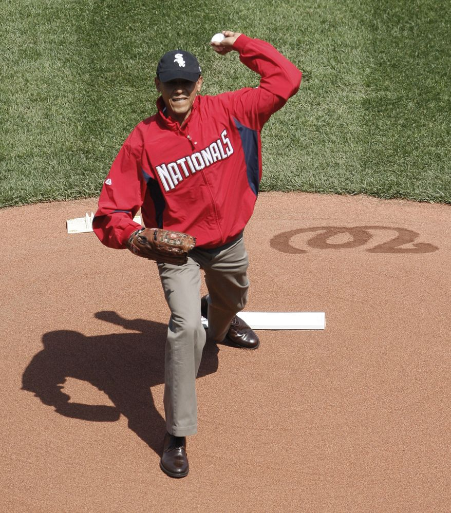 President Obama, wearing a Washington Nationals jacket and a Chicago White Sox hat, delivers the ceremonial first pitch during Opening Day ceremonies for a baseball game between the Philadelphia Phillies and Washington Nationals on Monday, April 5, 2010, at Nationals Park in Washington. (AP Photo/Pablo Martinez Monsivais)