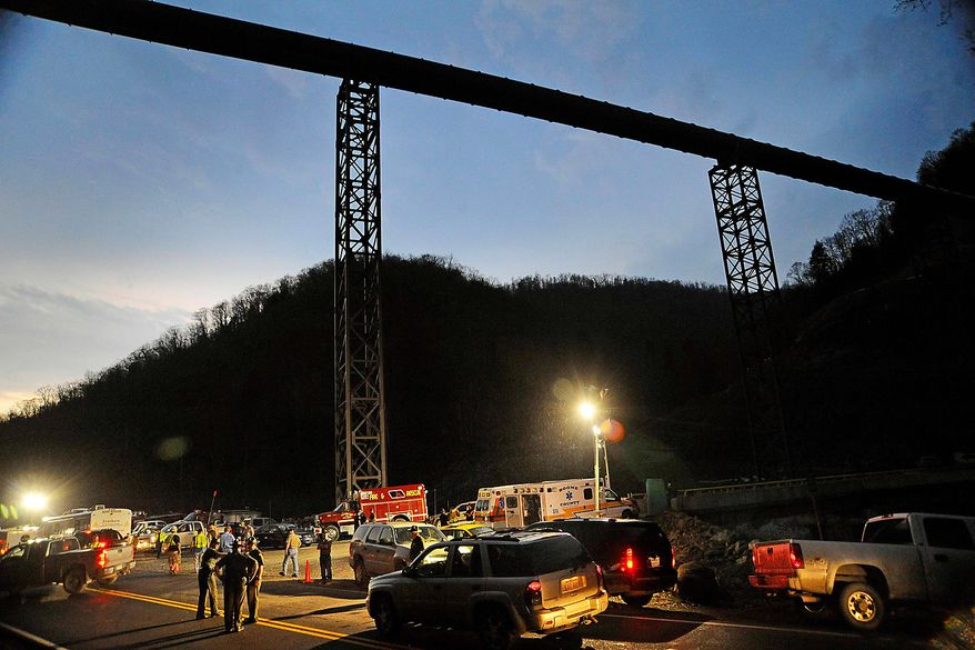 West Virginia State Police direct traffic at the entrance to Massey Energy's Upper Big Branch coal mine on Monday, April 5, 2010, in Montcoal, W.Va.  (AP Photo/Jeff Gentner)** FILE **