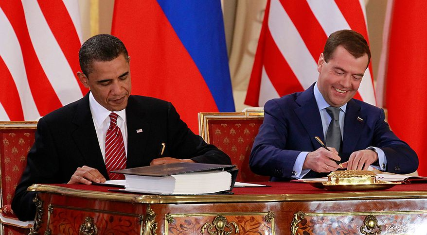 President Barack Obama signs the New START treaty with Russian president Dmitry Medvedev at the Prague Castle in Prague Thursday, April 8, 2010. (AP Photo/Alex Brandon)