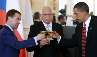 President Barack Obama, right, toasts with Russian president Dmitry Medvedev, left, and Czech Republic president Vaclav Klaus at the Prague Castle in Prague Thursday, April 8, 2010. The two leaders signed the New START treaty later in the day.(AP Photo/Alex Brandon)