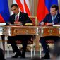 U.S. President Barack Obama, left, and his Russian counterpart Dmitry Medvedev, right, sign the 'New START'  nuclear arms reduction treaty at Prague Castle Thursday, April 8, 2010. (AP Photo/CTK, Roman Vondrous)
