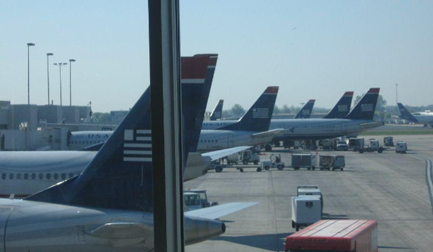 **FILE** US Airways aircraft at the Charlotte Douglas International Airport (Nicholas Kralev/The Washington Times)