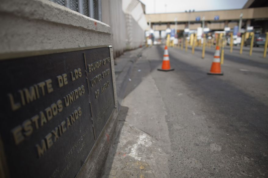 A sign marks Mexico's border with the United States as lanes are closed at the San Ysidro port of entry in Tijuana, Mexico, on Saturday, April 17, 2010. (Associated Press)
