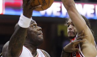 Cleveland Cavaliers' Shaquille O'Neal (33) goes up for a shot against Chicago Bulls' Joakim Noah in the first quarter of Game 2 in the first round of the NBA basketball playoffs Monday, April 19, 2010, in Cleveland. (AP Photo/Mark Duncan)