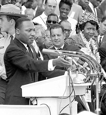 """In this Aug. 28, 1963 file photo, Dorothy Height, right, National President of the National Council of Negro Women and Director of the center for Racial Justice of the national YWCA, listens as the Rev. Dr. Martin Luther King Jr., gestures during his """"I Have a Dream"""" speech as he addresses thousands of civil rights supporters gathered in front of the Lincoln Memorial for the March on Washington for Jobs and Freedom in Washington, D.C. Height, who as longtime president of the National Council of Negro Women was the leading female voice of the 1960s civil rights movement, died Tuesday, April 20, 2010. She was 98. (AP Photo, File)"""