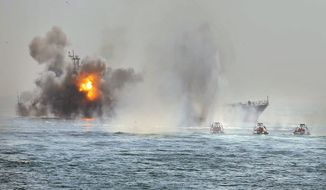 FARS NEWS AGENCY VIA ASSOCIATED PRESS Iranian Revolutionary Guard boats (right) attack an abandoned warship during the start of war games in the Persian Gulf on Thursday. Iran has been holding such maneuvers in the Gulf and Strait of Hormuz every year since 2006 to show off its military capabilities. Associated Press could not verify the content, date or location of the image.