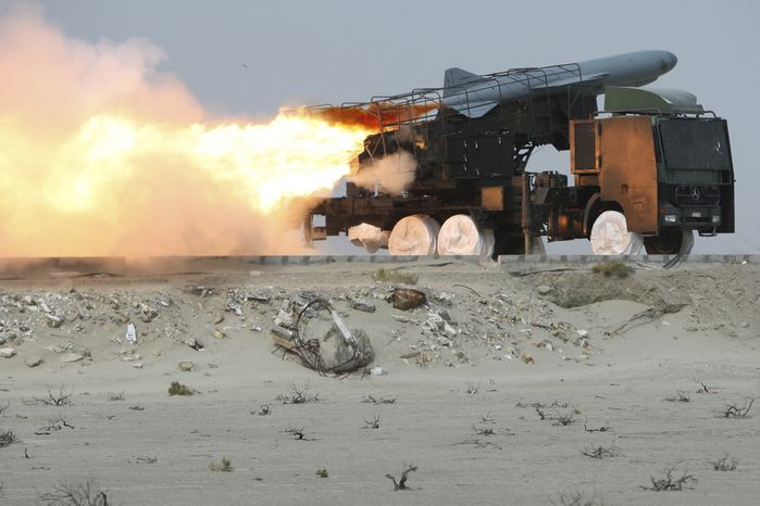 In this photo released by the semiofficial Iranian Fars News Agency, a Saegheh ground-to-sea missile is launched by the Iranian Revolutionary Guards during a maneuver at the eastern part of Strait of Hormuz, a strategic oil route in southern Iran, on Sunday, April 25, 2010. Iran's state television says the country has fired a series of missiles as part of an ongoing large-scale military maneuvers in the Persian Gulf and Strait of Hormuz. (AP Photo/Fars News Agency, Mehdi Marizad)