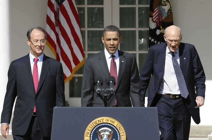 President Barack Obama, flanked by National Commission on Fiscal Responsibility and Reform Co-Chairmen, former White House Chief of Staff Erskine Bowles, left, and former Wyoming Sen. Alan Simpson, walk to a podium in the Rose Garden of the White House in Washington, Tuesday, April 27, 2010. (AP Photo/J. Scott Applewhite)