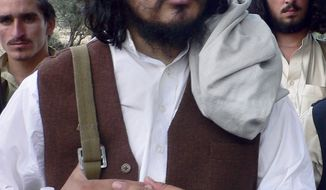 In this Oct. 4, 2009, file photo, Pakistani Taliban chief Hakimullah Mehsud arrives to meet with media in Sararogha of Pakistani tribal area of South Waziristan along the Afghanistan border. Mehsud is now believed to have survived a U.S. missile strike earlier this year, but has lost clout within the militant network, a senior intelligence officials said Thursday, April 29, 2010. (AP Photo/Ishtiaq Mehsud, File)
