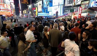 "A crowd gathers in Times Square near 46th Street in New York Saturday, May 1, 2010. Police have closed some streets in New York City's Times Square as they investigate a car that has been ""deemed suspicious."" (AP Photo/Craig Ruttle)"