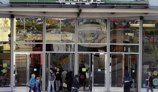 Shoppers enter or leave a Macy's department store in San Francisco in April 2010. (AP Photo/Marcio Jose Sanchez)