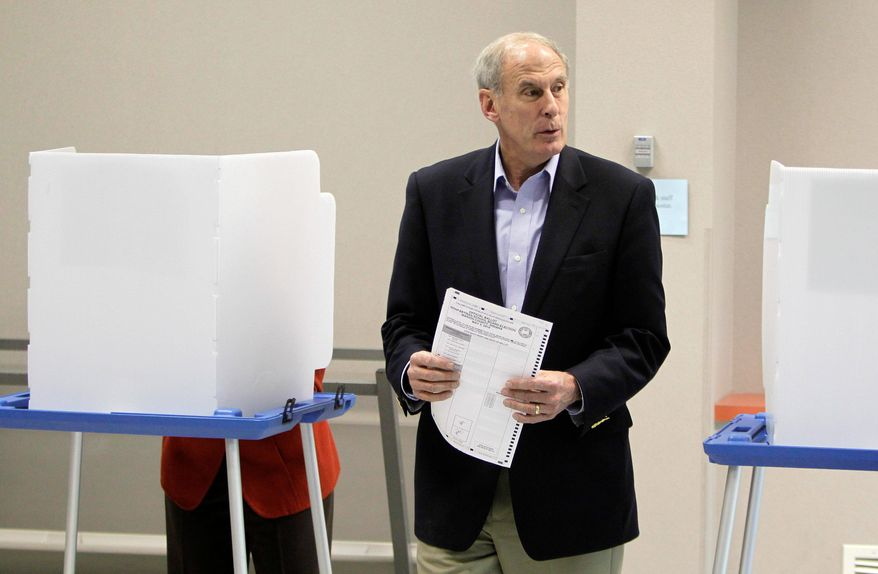 A Republican candidate for the U.S. Senate, Dan Coats, casts his vote in Indianapolis on Tuesday. Mr. Coats, who won his primary, spent 10 years in the Senate before leaving in 1998. He moved to Virginia, where he has worked as a lobbyist. He also bought a home in North Carolina, prompting critics to call him a carpetbagger for seeking a Senate seat from Indiana again. (Associated Press)