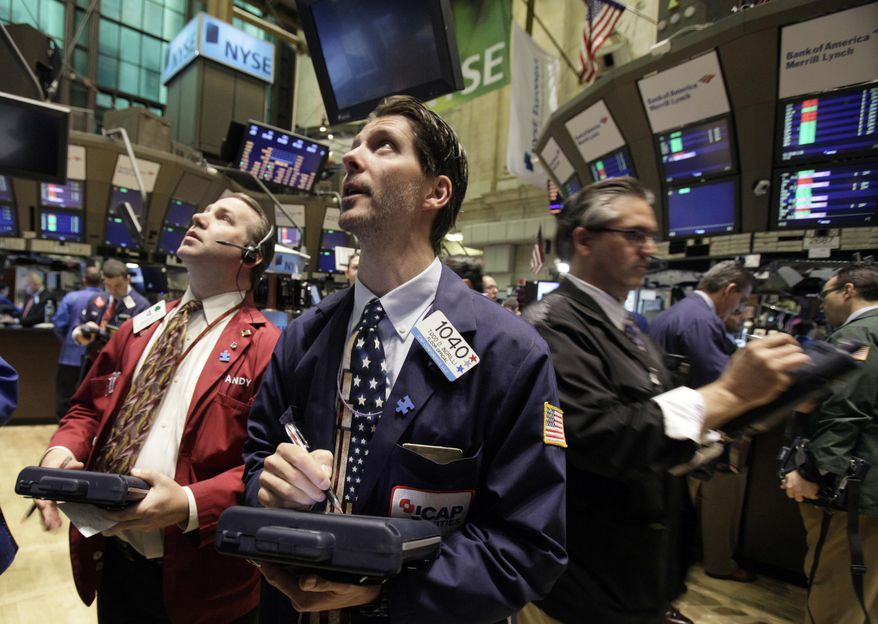 Traders work on the floor of the New York Stock Exchange Friday, May 7, 2010, a day after a dramatic tumble in the stocks. (AP Photo/Richard Drew)