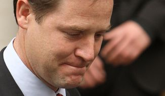Liberal Democrats leader Nick Clegg leaves the party's national headquarters on Cowley Street in London on Sunday, May 9, 2010. (AP Photo/Dominic Lipinski/PA)