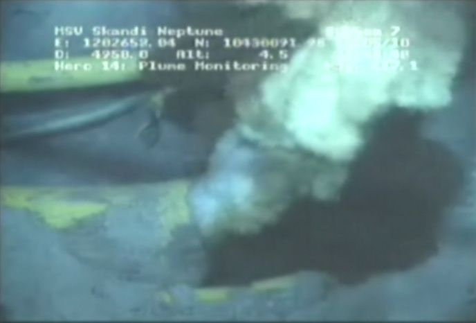 ** FILE ** This image from a video released by BP PLC shows oil and gas spewing from a yellowish, broken pipe 5,000 feet below the surface. The video, released on Wednesday, May 12, 2010, gives a not-yet-seen glimpse of the leaking well a mile underwater. (AP Photo/BP PLC, File)