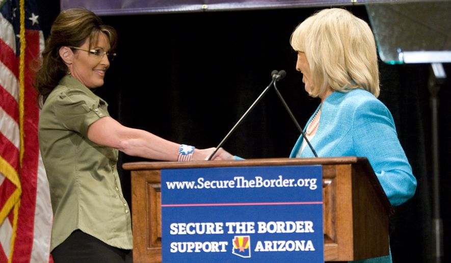 Former Alaska Gov. Sarah Palin, left, shakes the hand of Arizona Gov. Jan Brewer while speaking at a news conference about border security at the JW Marriott Desert Ridge in Phoenix on Saturday, May 15, 2010. Brewer and Palin blamed President Barack Obama for the state law cracking down on illegal immigration, saying the measure is Arizona's attempt to enforce immigration laws because the federal government won't do it. (AP Photo/The Arizona Republic, David Wallace)
