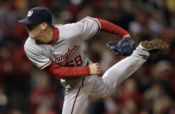 Washington Nationals relief pitcher Drew Storen throws during the seventh inning of a baseball game against the St. Louis Cardinals on Monday, May 17, 2010, in St. Louis. (Associated Press file)