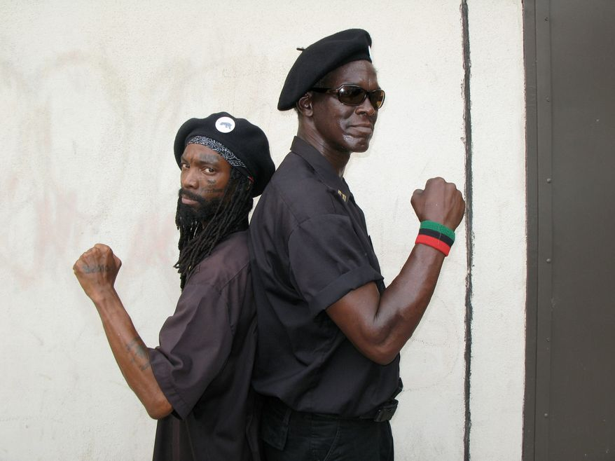 """** FILE ** Originally photographed for the National Geographic Channel show """"Inside,"""" King Samir Shabazz (left) and Jerry Jackson pose showing the """"black power"""" sign with their fists on June 8, 2008, in Philadelphia. (National Geographic Channels/© Marco Williams/M2 Pictures)"""