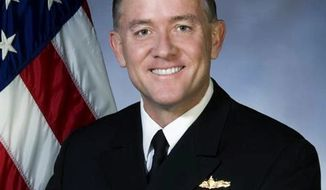 BRINGING IN THE BIG GUN: Vice Adm. Bruce MacDonald will be the authority on war-crime trials. (U.S. Navy)