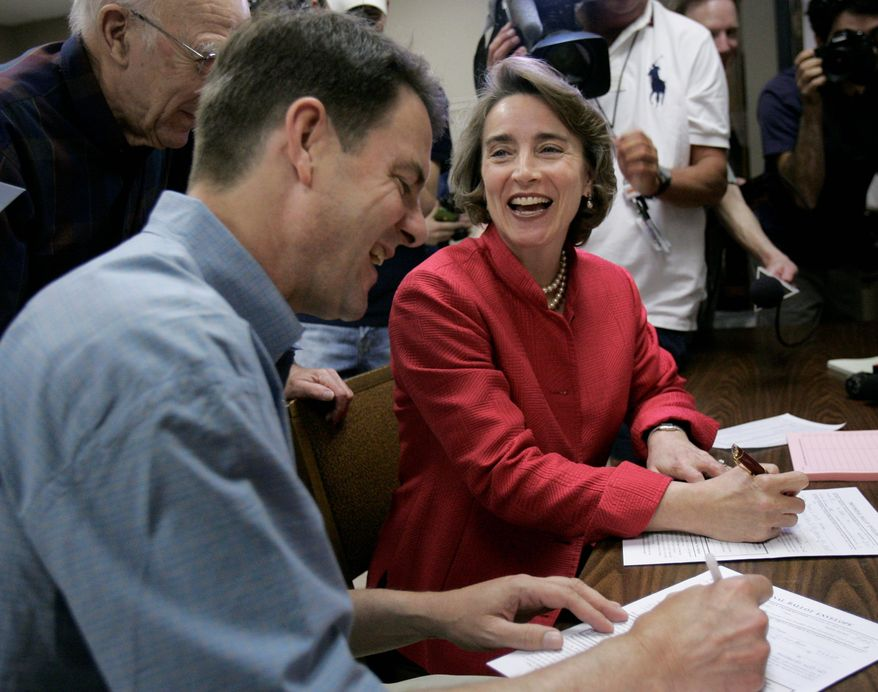 """Sen. Blanche Lincoln and her husband, Steve, fill out paperwork at their polling place in Little Rock, Ark. The Democrat remained confident on Tuesday afternoon, issuing a statement declaring she """"has fought off this challenge from outside groups and ends the primary election period battle tested."""""""