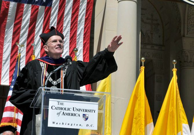 ** FILE ** Monsignor David M. O'Connell, former president of Catholic University of America, speaks last month during the Catholic University of America commencement ceremony. He has been replaced by John Garvey, the former dean of Boston College Law School.